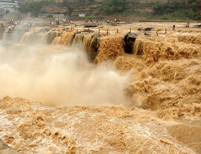 The Hukou Waterfall of the Yellow River gushing with flood water on July 5. Photo by Yan Yuepeng/CFP _The Yellow Rivers Flood Upon Flood