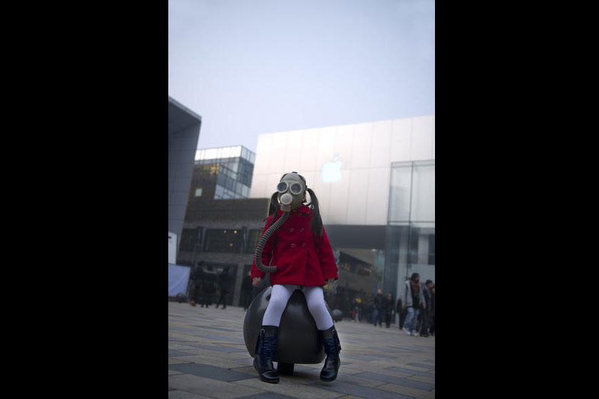 Sealed off from what has come to be the regular standard of air quality in Beijing, a young girl with a gas mask sits in Beijing's popular Sanlitun shopping area on January 13. Wu Di Greenpeace/CFP