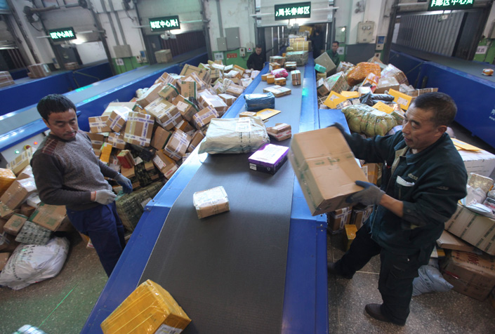China Post workers dispatch Singles Day packages in Changchun, Jilin province, in mid-November. Chinese delivery companies were delivering about 125 million packages a day leading up to Singles Day, which is Nov. 11. Photo: China Visual