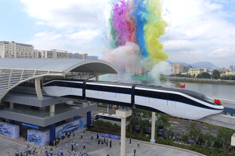 """2016年10月13日,比亚迪""""云轨""""通车仪式在深圳坪山总部举行."""