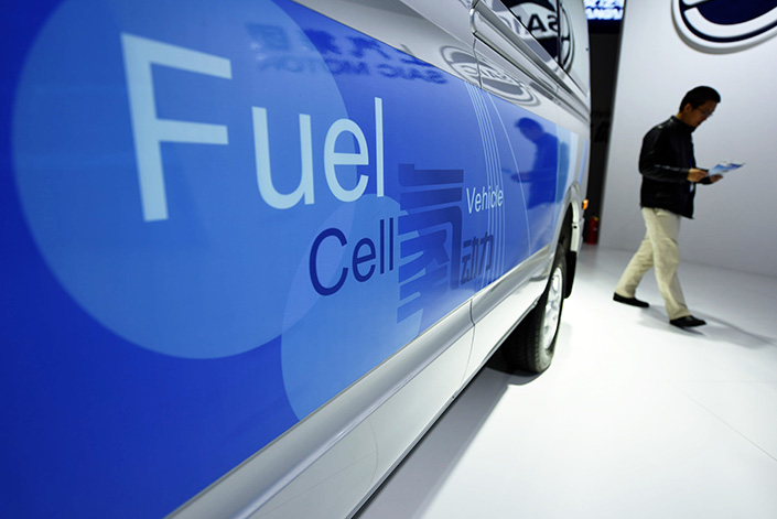 A visitor walks past a new-energy car at the China International Industry Fair in November 2016. Sales of new-energy vehicles plunged 70% in January, affected by seasonal factors and cutbacks in government subsidies. Photo: IC