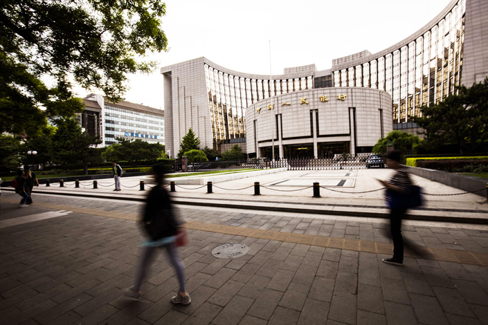 The People's Bank of China has issued a research paper that says market forces need to play the decisive role in reducing the debt in the country. Photo: IC