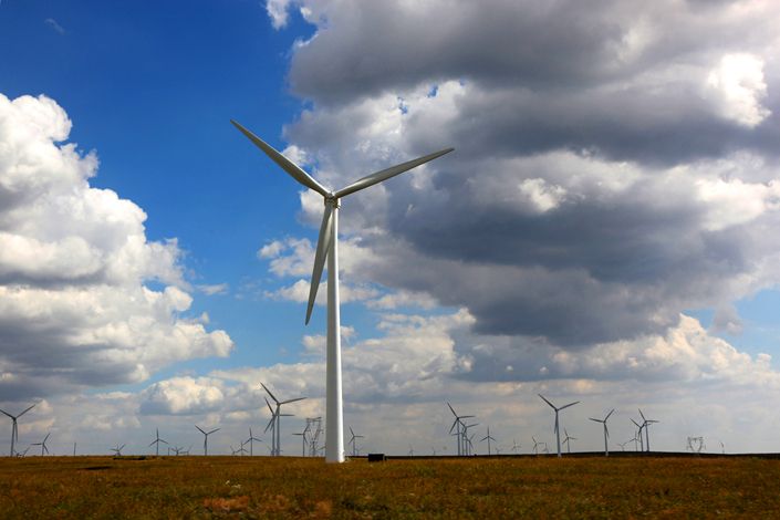 Windmills for generating electricity are seen in the Inner Mongolia autonomous region in August 2015. China's National Energy Administration has suspended any new wind-power projects in six provincial-level governments, saying they had too many wind farms unconnected to the national grid. Photo: Visual China