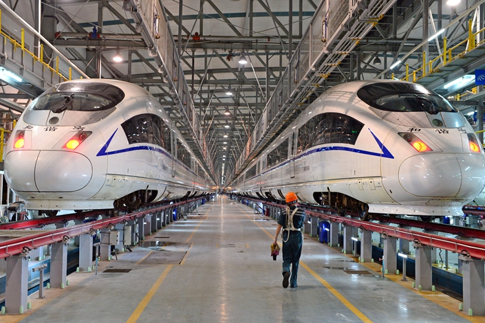 Trains await maintenance in Anhui, Hefei province, on July 26. China Railway Corp. said the breakdown rate for high-speed rail vehicles dropped 15% in 2016. Photo: IC