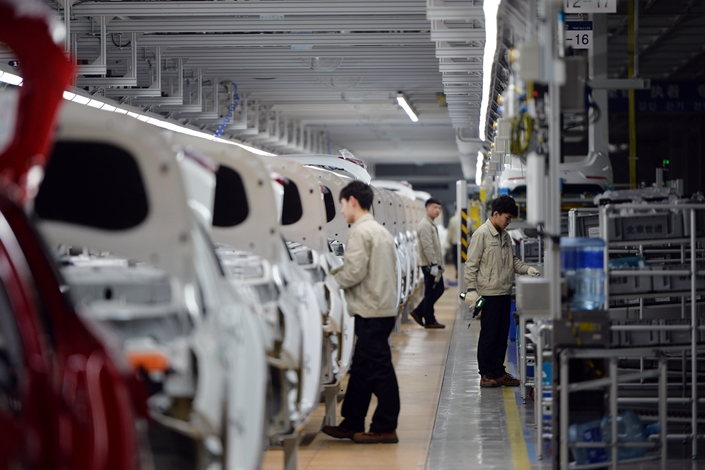 Workers work in a car factory in North China's Cangzhou, Hebei province on Feb. 21. Photo: Visual China