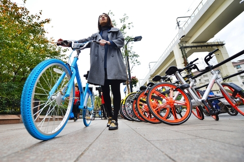 Shanghai Set to Spin New Curbs on City's Bike-Sharing Operators