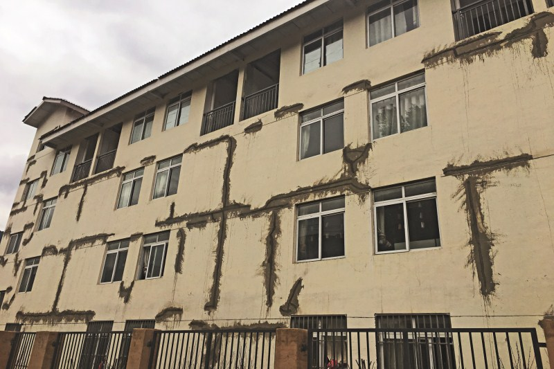 Many new concrete structures in Yunnan province, built after a Feb. 8 earthquake there, are already showing cracks. Local government officials insist the structures are structurally sound. Above, cracks in one kindergarten (preschool) built by Yunnan Construction Engineering Group are visible after the earthquake.Photo: Shenfan/Caixin