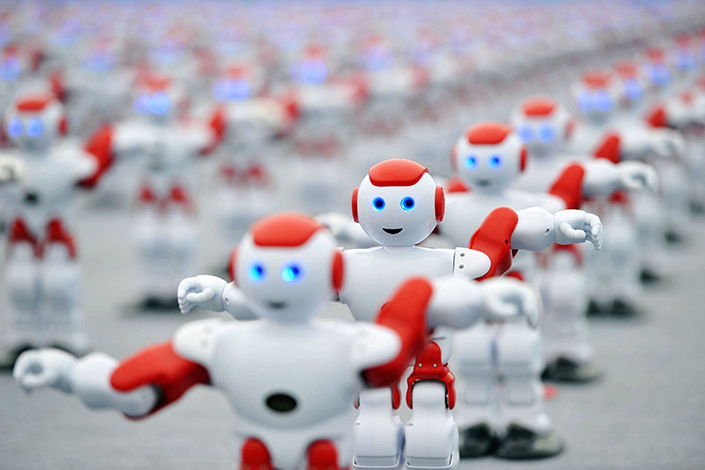 Many fear that the growing popularity of robots and artificial intelligence will lead to unmanageable job losses. Above, 1,050 the One thousand fifty robots dance simultaneously at the 26th Qingdao International Beer Festival in Qingdao, Shandong province, on July 30, 2016. Photo: Visual China