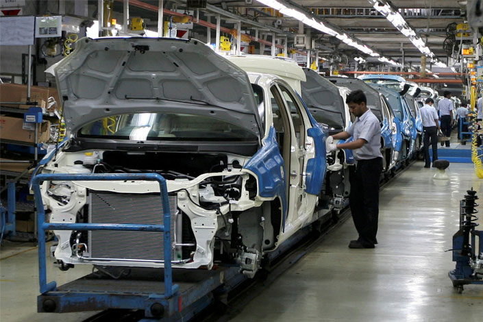 Employees work at the General Motors Plant at Halol, Gujarat. The U.S. automaker is halting sales of its Chevrolet vehicles after two decades in India. Photo: Visual China
