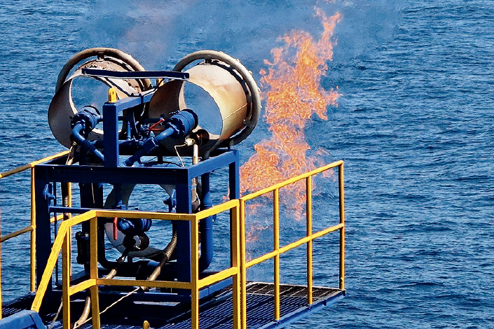 Flames from burning methane shoot from the Japanese deep-sea scientific drilling vessel CHIKYU near Aichi prefecture, Japan, on March 12, 2013. Photo: Xinhua