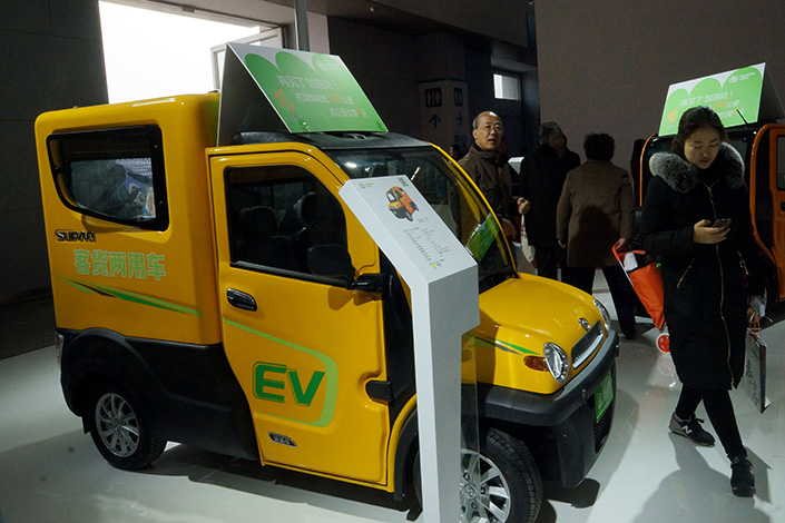 The Legislative Affairs Office of the State Council is mandating new-energy vehicle quotas of 8%, 10% and 12% for car producers  for the years 2018, 2019 and 2020 respectively. Above, a newsenergy vehicle is displayed at an E-bike expo in Tianjin on March 25. Photo: Visual China