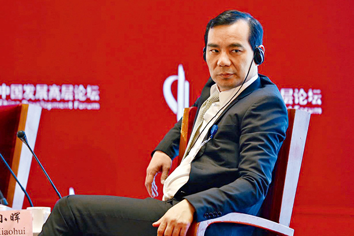 Wu Xiaohui, chairman of Anbang Insurance Group Co., attends the China Development Forum in Beijing on March 18. Photo: Visual China