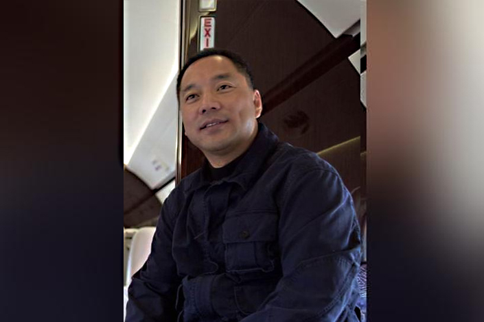Three former employees of Chinese fugitive tycoon Guo Wengui, above, were sentenced to prison on Friday for obtaining loans and foreign currency with fraudulent documents under Guo's instruction.