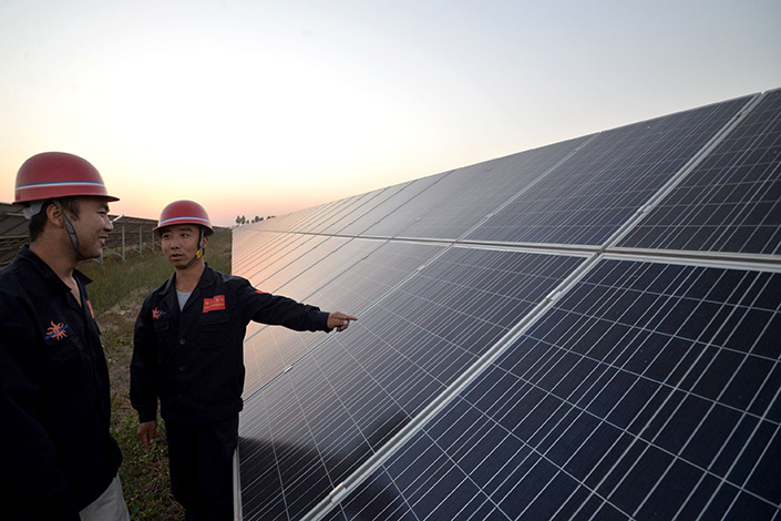 Two of China's weakest major solar panel makers, Yingli and ReneSola, said revenue plunged by nearly half in their latest reporting quarters. Above, a Yingli photovoltaic power station is seen in Handan, Hebei province, in October 2015. Photo: IC