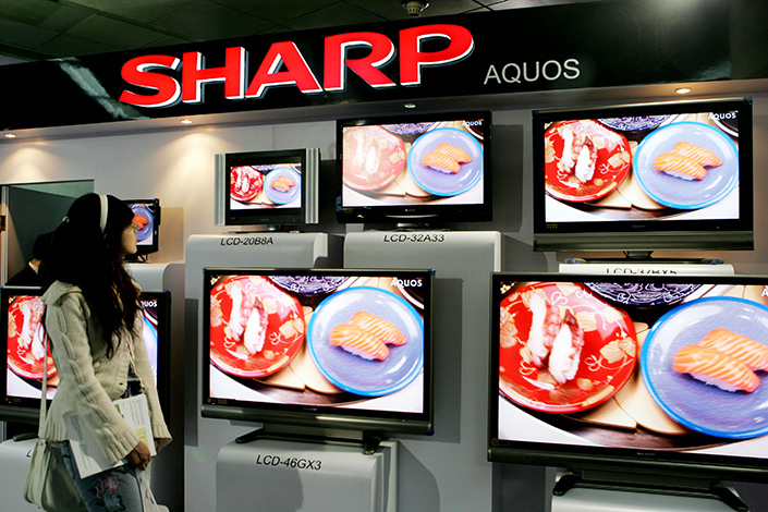 Sharp Corp. has dropped a lawsuit against Hisense Co. for allegedly misusing a trademark contract in the U.S. that it said devalued its brand. Above, Sharp televisions are displayed at an information and technology exhibition in Beijing in 2008. Photo: Visual China