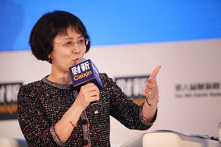 Caixin Media Editor-in-Chief Hu Shuli told a conference at the University of Oxford on Monday that China should continue embracing a market economy even though the concept has been challenged in the West this year. Above, Hu speaks at the 6th Caixin Summit in Beijing in November 2015. Photo: Chen Weixi/Caixin