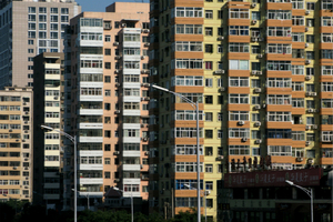 Government Curbs Continue to Cool Home Price Growth in May