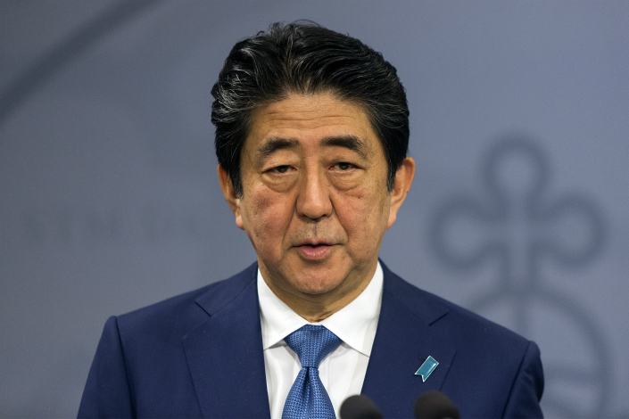 Japanese Prime Minister Shinzo Abe had tried to reset Japan-China relations in 2006 during his first term as prime minister. But what has motivated Abe to again extend an olive branch? Above, Abe gives a speech on Monday in Copenhagen, Denmark. Photo: Visual China