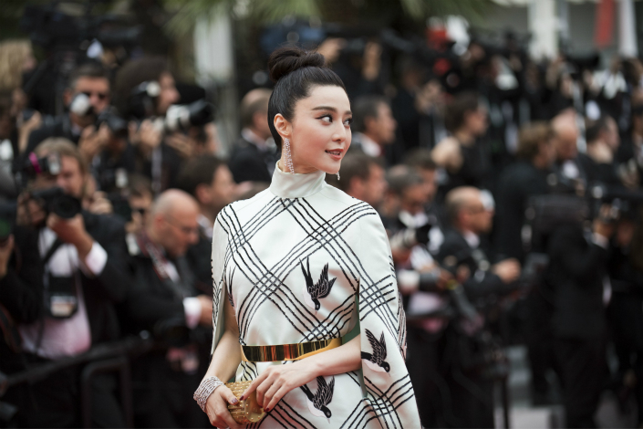 Chinese Star Fan Bingbing has vowed to take fugitive businessman Guo Wengui to U.S. court after she claims he 'viciously' defamed her. Above,  Fan attends the Cannes Film Festival in France on May 26. Photo: IC