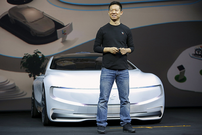 LeEco's listed unit is set for over 600 million yuan ($89 million) in losses for the first six months of this year, LeEco forecast Friday evening. Above, company founder Jia Yueting unveils the LeSEE, LeEco's fully electric car, in Beijing in April 2016. Photo: Visual China