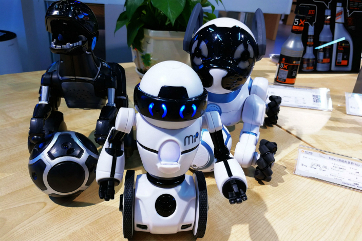 Intelligent robots are sold in a Suning appliance store in July in Qingdao, Shandong province. Photo: Visual China