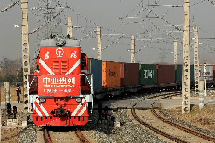 Reducing trade barriers, a principal objective of the Belt and Road initiative, is important, especially given the limited success that international organizations have had in promoting economic growth in developing countries. Above, a freight train carrying high-quality cotton yarn from Central Asia arrives in Xi'an, Shaanxi province, on Feb. 24. Photo: Visual China