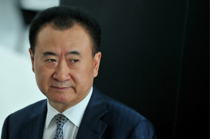 Wanda Group has filed suit against several media outlets for reporting that founder Wang Jianlin was prevented from leaving China, reports the company denies. Wang is seen here in a file photo. Photo: Visual China