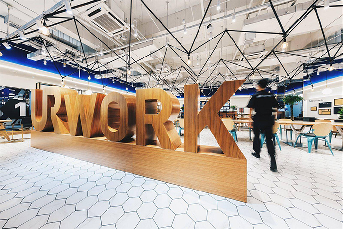"""WeWork Companies Inc. said in a case filing to U.S. federal court on Tuesday that rival UrWork has a """"confusingly similar name"""" that """"will deceive potential customers into believing that UrWork's services come from, are affiliated with or are sponsored by WeWork."""" Above, a UrWork shared-office space is seen in the Jiuxianqiao area of Beijing on July 20. Photo: UrWork"""