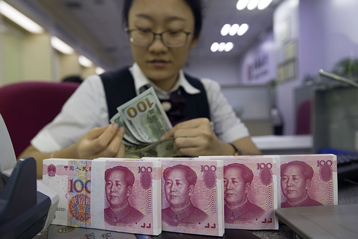 China has been trying to limit the rise of the yuan this year that was largely brought about by a weaker dollar and China's stabilizing economic growth prospects. Photo: Visual China