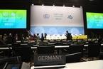 波恩气候大会形成两大阵营 《多哈修正案》是否履行成谈判焦点
