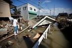 日本西部暴雨成灾已致126人死亡 安倍取消外访