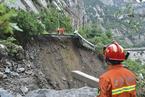 北京暴雨触发四项预警  多路段积水交通中断