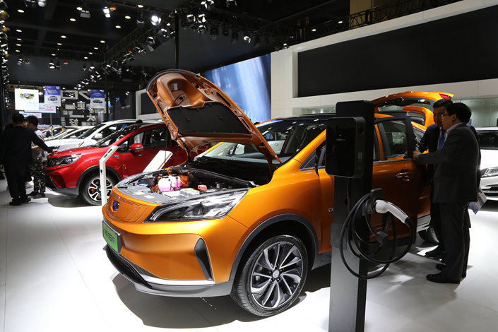 geely automobile showcases its pure electric vehicle models at an auto show  in northern china on