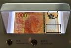 一张钞票印28天 香港印钞公司详解新港元印刷流程