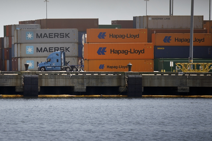 Stacks of shipping containers sit along the dock at the New York Container Terminal in Staten Island. Photo: VCG