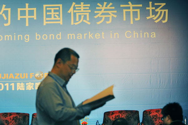 The wave of defaults has reduced investors' risk appetite for Chinese corporate bonds. Photo: VCG