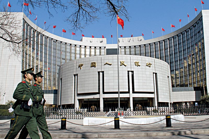The People's Bank of China (above) and other regulatory bodies are hoping new rules will direct bond repurchase practices into a more transparent and regulated track. Photo: Visual China