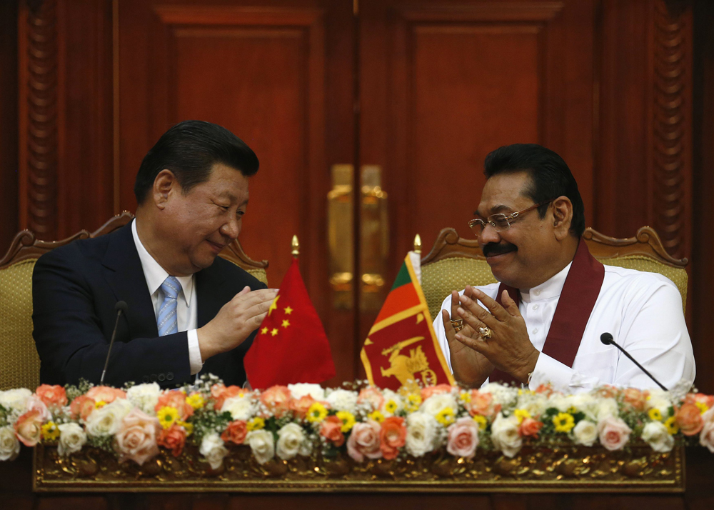 Xi Jinping and Mahinda Rajapaksa (right)