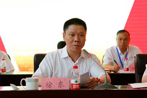 Xu Dong at a meeting in Urumqi in July