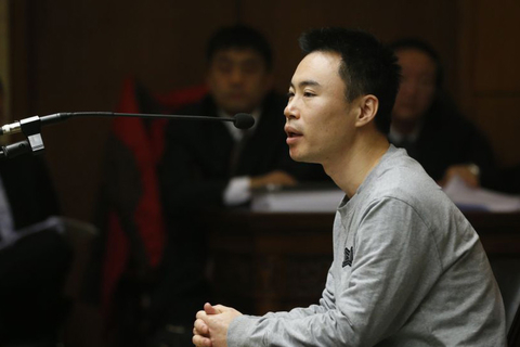 Wang Xin, CEO of Shenzhen Qvod Technology, speaks at his trial in a Beijing court on January 7