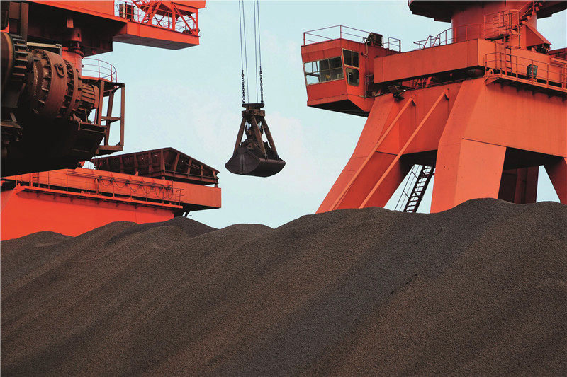 China's raw material futures slumped on Thursday led by iron ore and coking coal contracts. Above Iron-ore stockpiles at a Chinese port