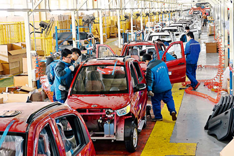 Workers assemble cars in an electric car factory in Weifang, Shandong province on March 1. Photo: IC