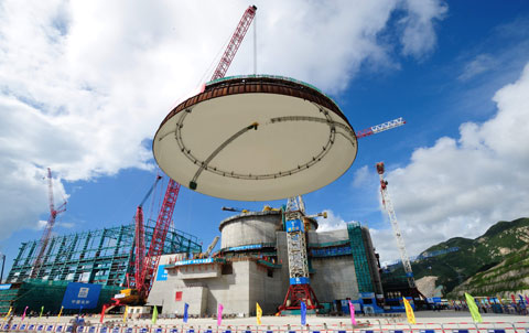 A containment structure dome is hoisted into place for one of  two reactors at the Taishan Nuclear Power Plant in Guangdong province during its construction phase in 2012. Photo: IC