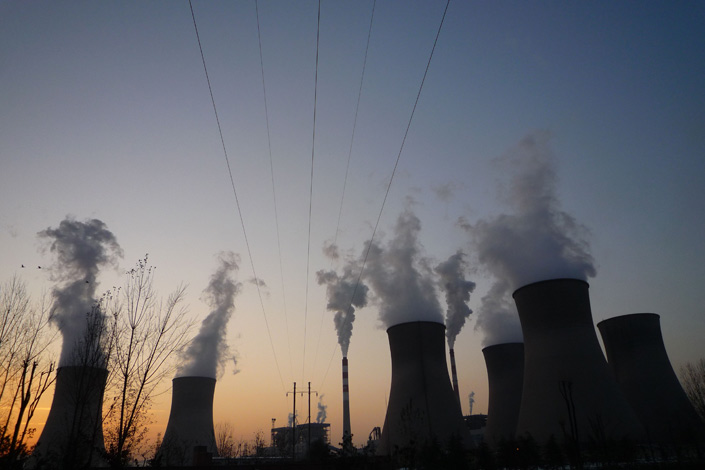 Pollutants pour out of cooling towers at a coal-fired power plant in Shijiazhuang, Hebei province. Photo:IC
