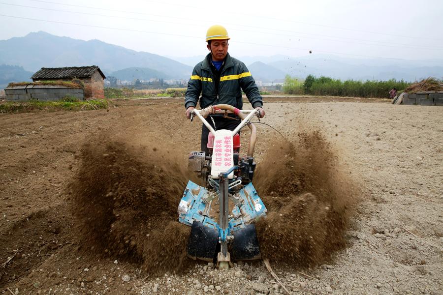 A farmer works in the fields of Rongjiang, Guizhou province, on Feb. 24, when the local peak farming season begins. Photo: Visual China
