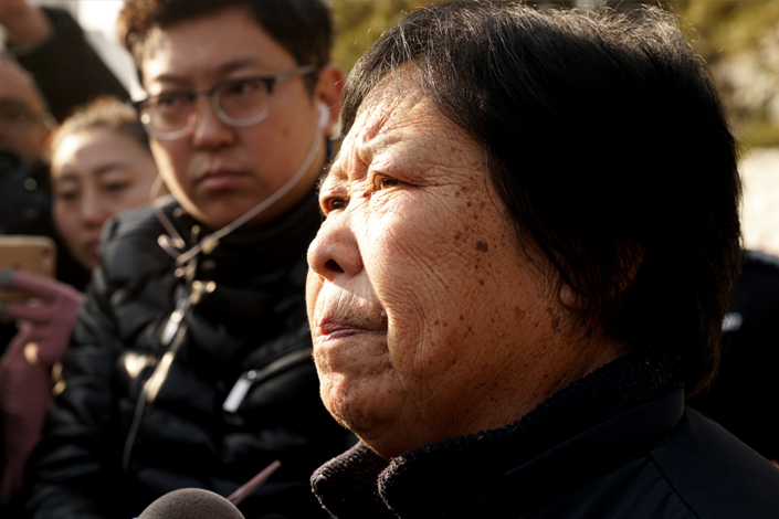 Zhang Huanzhi, the mother of Nie Shubin, who was sentenced to death and executed 21 years ago, talks to the media after her son was found not guilty by the Supreme People's Court on Friday. Photo: Guo Xianzhong/Caixin