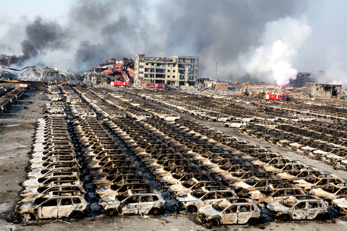 Dozens of massive explosions at chemical warehouses on Aug. 12, 2015, in northeastern China's Tianjin municipality filled the sky with smoke and turned a parking lot of new cars into a pile of charred remains. Photo: IC
