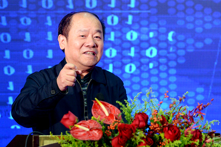 Ning Jizhe, head of the National Bureau of Statistics and vice chairman of the National Development and Reform Commission, speaks at the 2016 Guohong Macro-economy Forum in Beijing on Sunday. Photo: Visual China