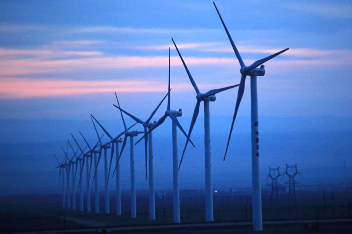 Wind turbines are seen at the Naomao Lake power station in Xinjiang on Mar. 21. Photo: Visual China