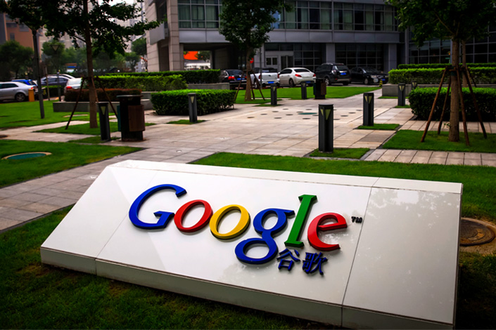 The Google logo is seen on a sign in front of its Beijing office in July 2013. Photo: Visual China
